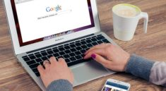 Woman searching for a business on Google while implementing SEO in Glasgow
