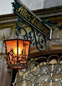 Old fashioned wrought iron sign outside pub with name Altes labhaus