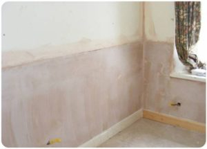 Wall with fresh plaster after rising damp solution has been applied