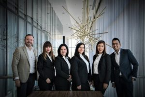 Team of six people in business suits ready for success