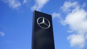 Tall black granite slab with silver Mercedes Logo
