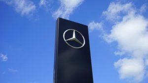 Tall black granite slab with silver Mercedes Logo