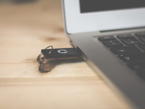 USB plugged into a macbook: example of technology for business
